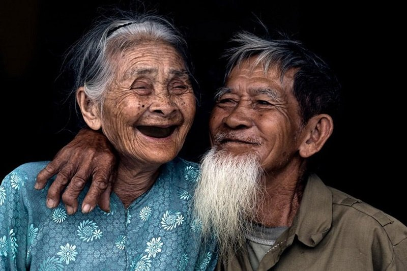 Hoi An's most famous couple, popularized by French photographer Réhahn
